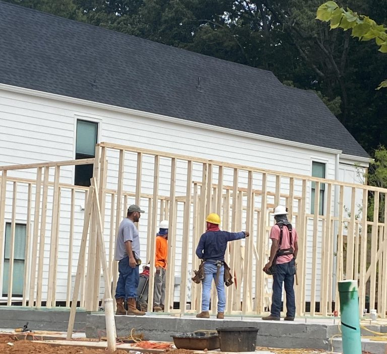 Framing new construction homes at Westown in Downtown Woodstock